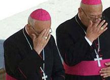 католики